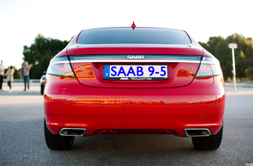 Red 2010 Saab 9-5 rear view